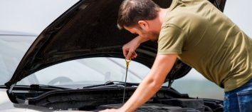 Man-checking-oil-in-car