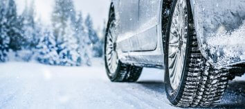 Snowy tires driving on a snowy road