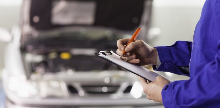 Paddock Imports working on vehicle maintenance in Denver